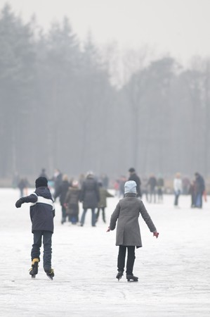 wintersport: children skating at the ice