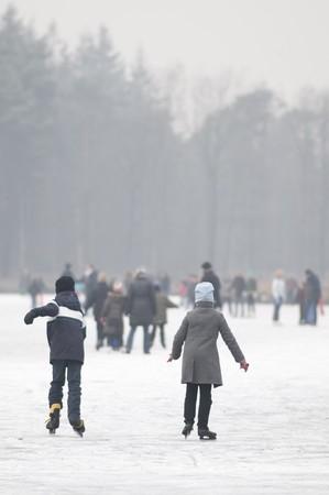 wintersport: children skating at the ice