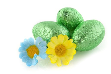 Green chocolate easter eggs wih flowers photo