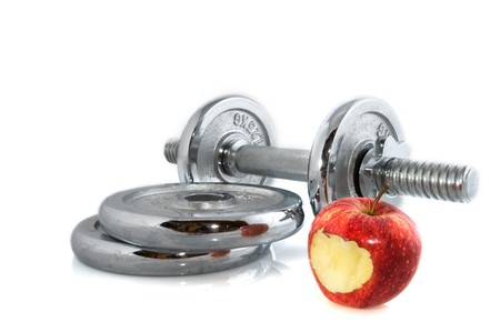 come in: Heavy dumbbells and apple to come in shape