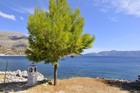 edifice: Greek coast with little edifice for in memoriam Stock Photo