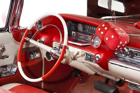 classic car: Red interior with steer and big hanging dices