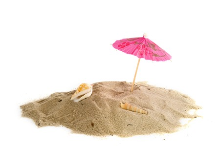 Tropical beach with pink parasol and shells