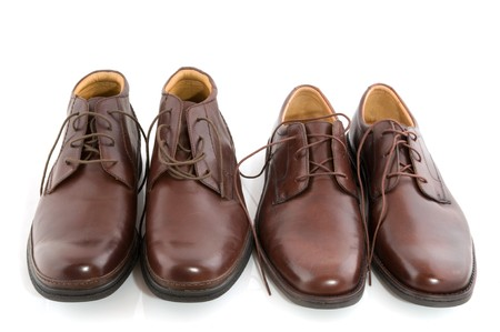 shined: shiny brown shoes high and low for man Stock Photo