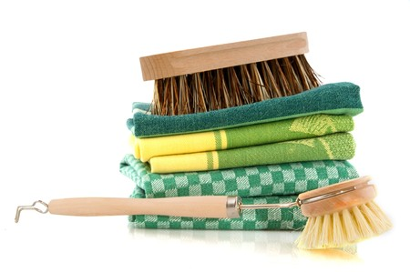 scrubbing: washing the dishes with dish clothes and scrubbing brushes Stock Photo