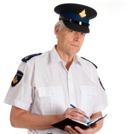 stringent: Dutch police man is writing a penalty