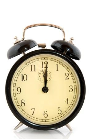 Alarm clock at twelve oclock Stock Photo