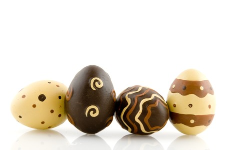 Chocolate easter eggs with decoration isolated over white