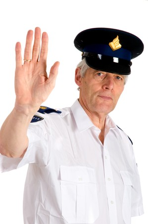 stringent: Police man is saying stop with hand Stock Photo