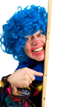 Pointing clown with memo board for text photo