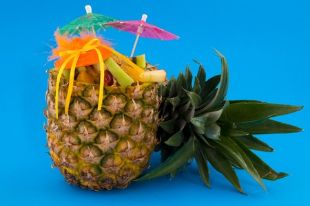 Tropical fruit cocktail with parasols and hat Stock Photo - 4508879