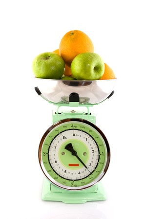 Green retro scale with oranges and apples photo
