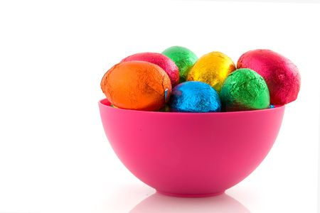 Pink bowl filled with chocolate easter eggs photo
