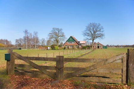 Dutch landscape with farmhouse fence and grass fields Stock Photo - 4680299