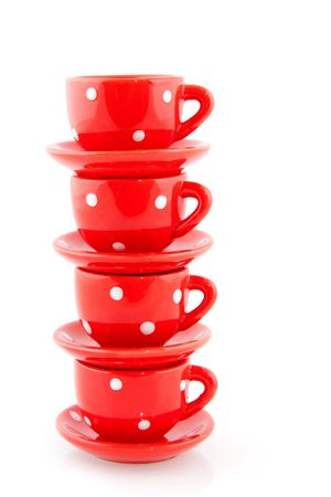 speckles: red cup and saucers stacked with speckles Stock Photo