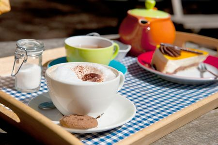 cup of tea or coffee at the terrace outdoor in cheerful crockery Stock Photo - 4763697