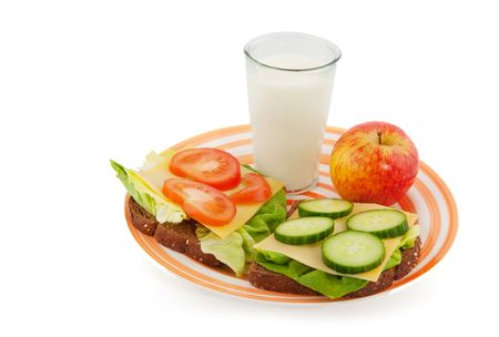 Healthy lunch with whole meal bread cheese and vegetables