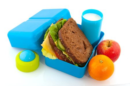 lunch box: Healthy filled lunch box with whole meal bread vegetables and milk