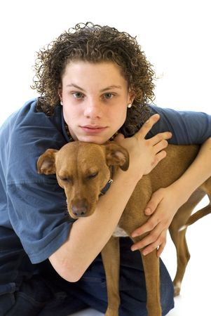 Young boy with his little brown dog photo