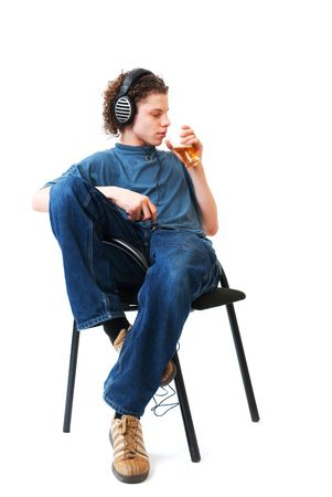 Young boy is listening to the music and drinking alcohol photo