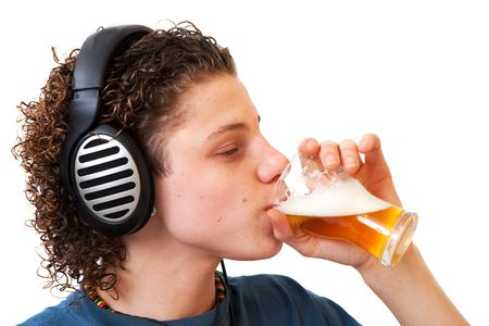 Young boy is listening to the music while drinking beer photo