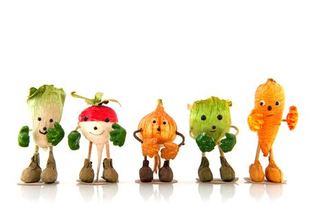 funny food: funny vegetables with hands, feet and a face