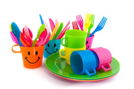 knifes: Plastic spoons forks and knifes in happy mugs