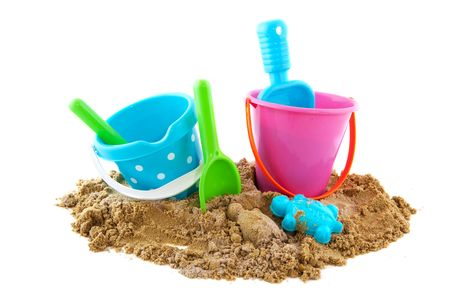 sandbox: Plastic toys at the beach isolated over white