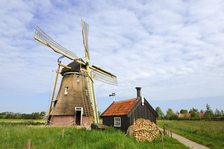 Dutch windmill in landscape Groot-Ammers photo