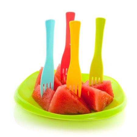 Prepared melon in cubes with colorful forks Stock Photo - 5163928
