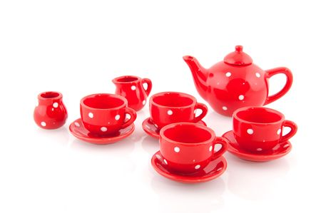 speckles: cheerful speckles red crockery isolated over white
