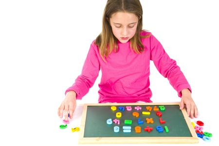 Little girl is working with numbers for educational purpose photo