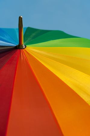 colorful parasol in front of a blue sky photo