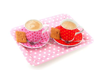 speckles: Two cups of coffee in speckles crockery with cookies