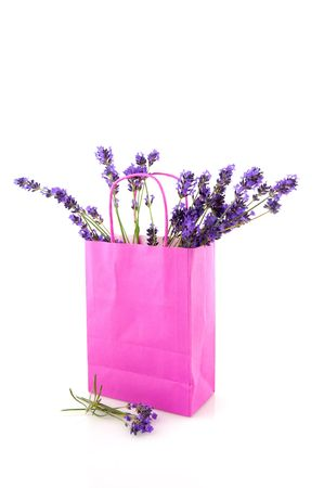bouquet lavender flowers in pink paperbag photo