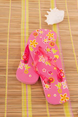 summer with cheerful sandals and shell on bamboo photo