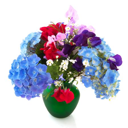 mixed flower bouquet: Cheerful bouquet of garden flowers in green vase isolated over white