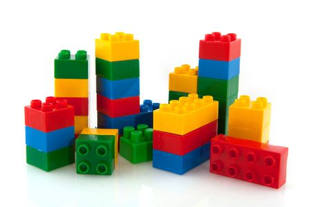 construction towers from colorful toys isolated over white Stock Photo