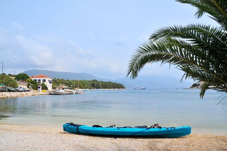 Kayak at the little village Fiscardo at the Greek island Kefalonia photo