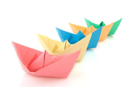 colorful folder paper boats isolated over white photo