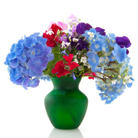 Cheerful bouquet of garden flowers in green vase photo