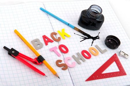old fashioned back to school with ink pot and pencil Stock Photo - 5345770