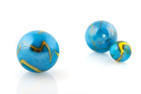 gambling stone: Blue marbles like globes isolated over white Stock Photo
