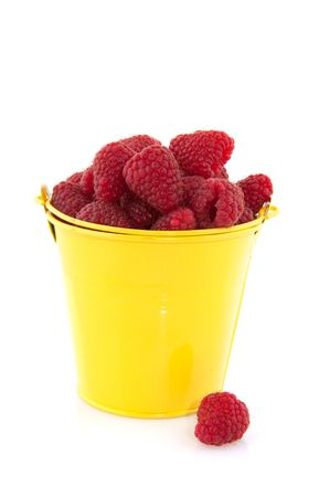 plucked: A yellow bucket with found and plucked raspberries Stock Photo