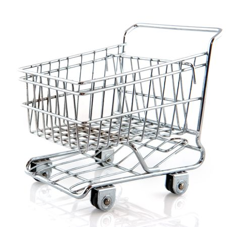 Metal shopping cart on wheels isolated over white Stock Photo - 5345898