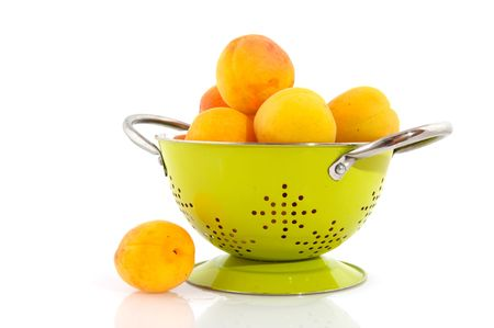a colander: Yellow prunes in colander Stock Photo