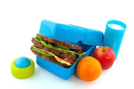 school lunch: Healthy lunch box with bread fruit and milk for take away Stock Photo
