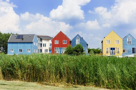 row of houses: Energy saving houses with solar cells on the roof Stock Photo