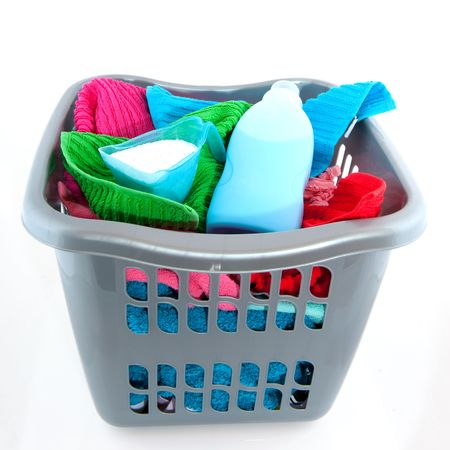 laundry basket filled with colorful towels isolated over white Stock Photo - 5570852