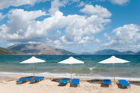 suntanning: Beach at the Greek ionian island Kefalonia with parasols